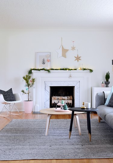 Pink accents in a minimal white and gray living room.