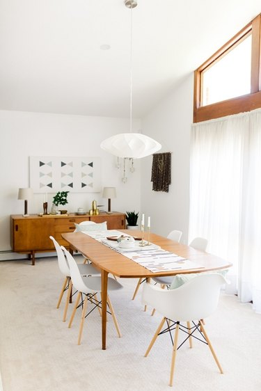 Neutral midcentury dining room idea with white accents