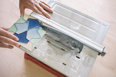 Cutting ceramic tile with wet saw