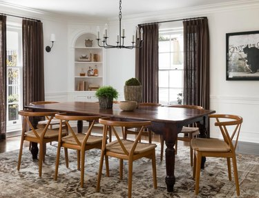 dining space with wood chairs and black chandelier