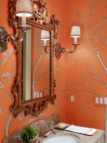 orange wallpaper in bathroom