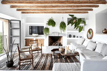 mediterranean style living room with wood ceiling beams
