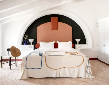white room with terra cotta color headboard