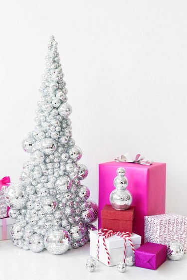 disco ball DIY Christmas tree with vibrant presents