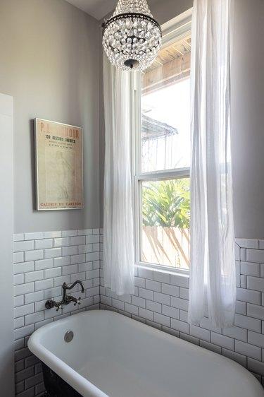 clawfoot bathtub with subway tile