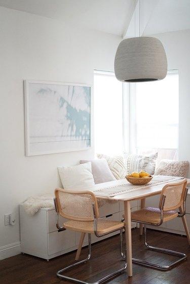 Modern dining room lighting idea with gray pendant light