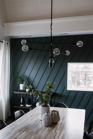 Blue and black dining room lighting idea with contemporary light fixture