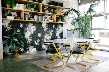 black dining room color idea with floral wallpaper and open shelving