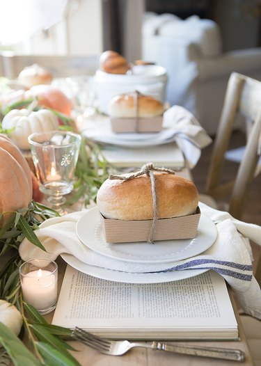 fall-inspired table decor with loaves of bread and books
