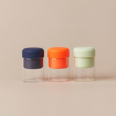 By Humankind's Mouthwash Containers in blue, green, and orange
