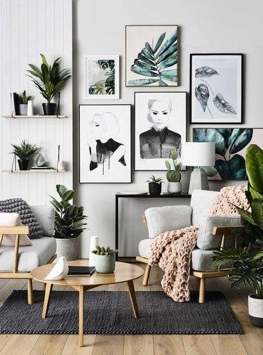 tropical living room with botanical artwork