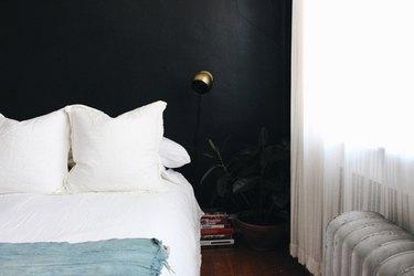 minimalist bedroom with black walls
