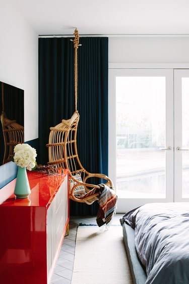 color that goes with navy blue, white room with navy curtains and red credenza and rattan hanging chair