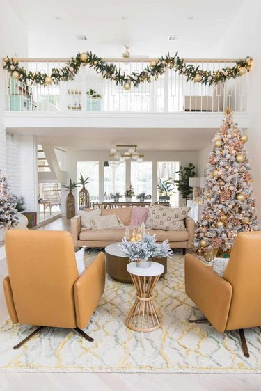 Modern 70s living room with yellow chairs and Christmas decor in warm colors