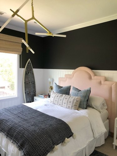 bedroom with white wainscot and black paint above