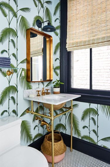 color that goes with navy blue, powder room with green and blue palm wallpaper