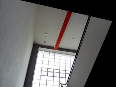Bauhaus architecture with modern interior seen in globe ceiling light and square shapes in windows