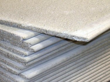 Stack of cementboard sheets.