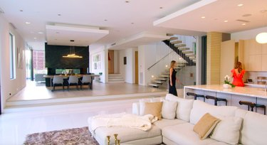 modern house interior with white couch and kitchen island nearby