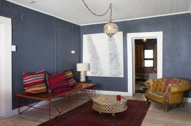This bohemian glass pendant complements the eclectic look of the room.