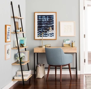 desk space with blue chair and shelf