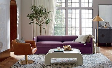 Bauhaus Furniture with brass lamp and purple couch