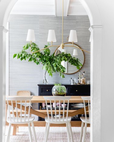 transitional gray dining room idea with textured sisal wallpaper