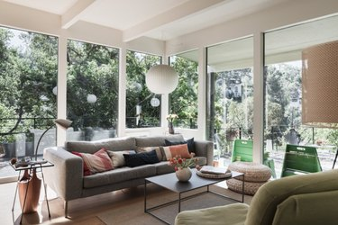 A ball pendant by Herman Miller compliments this mid-century living room.