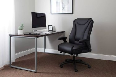 desk with monitor and ergonomic black chair