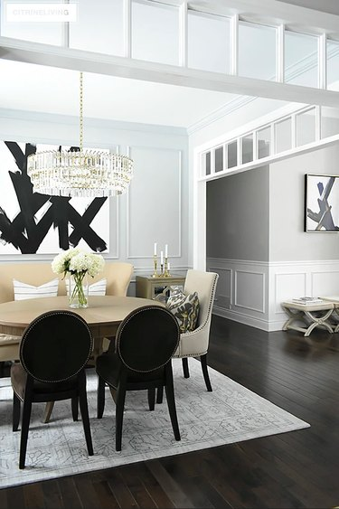Eclectic gray dining room idea with crystal chandelier and gray walls