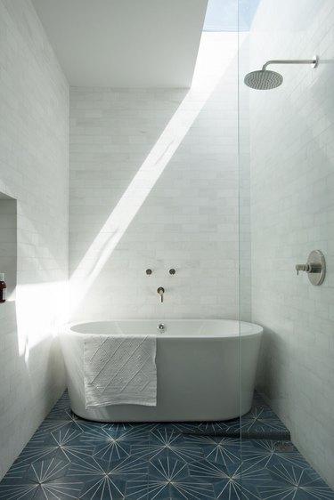 teal geometric tile bathroom floor