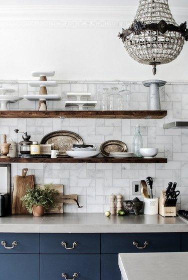 marble subway tile kitchen backsplash with open shelving