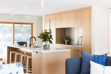 modern kitchen island in wood with white countertop