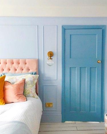 blue pastel bedroom with darker blue door frame Tone On Tone Paint Ideas