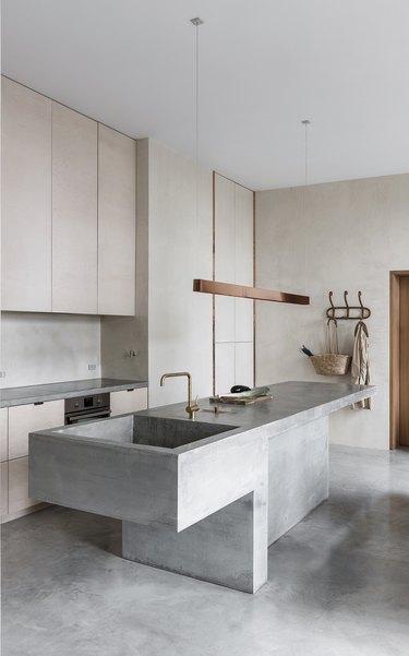 modern kitchen island made from concrete