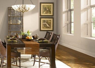 dining room space with beige walls and dark chairs