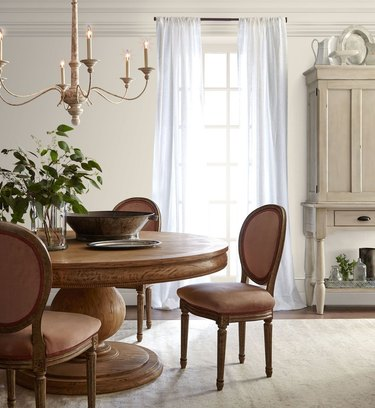 dining room space with beige walls and chandelier