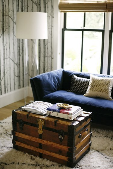 farmhouse living room with reclaimed chest as coffee table