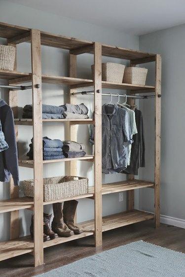 Freestanding industrial pipe closet idea in wood