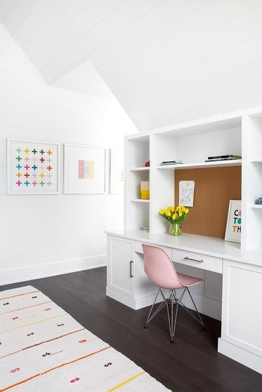 white attic idea with office and pink chair