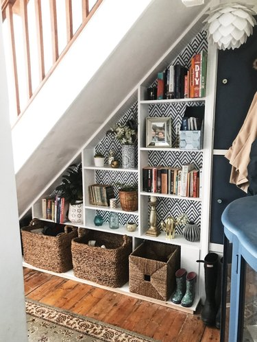 Under the stairs storage with white bookshelf and cubbies for decor and books
