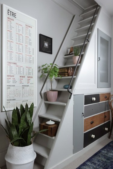 Under the stairs storage with mismatched vintage drawers and decor