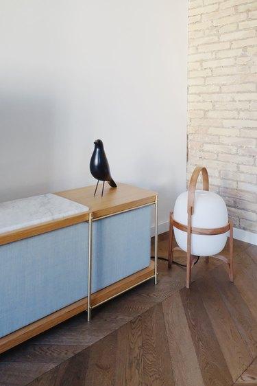 Bauhaus style room with modern sideboard, lantern, and bird sculpture