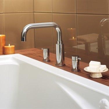 Deck-mounted bathtub faucet