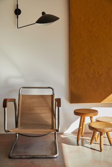 Bauhaus style room with modern wall sconce and Bauhaus chair