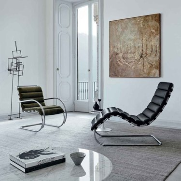 Bauhaus style room with modern chairs and contemporary sculpture