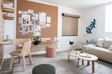 Home Office Organization Ideas at hunker house with cork board and gray couch