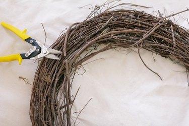 Clipping vine on grapevine wreath