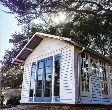 white Home office shed made of reclaimed wood