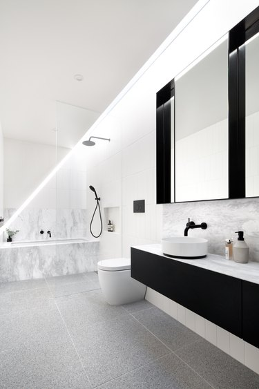 black and white Scandinavian bathroom with floating vanity